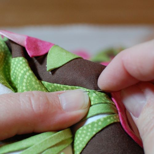 36.Coming up through the applique